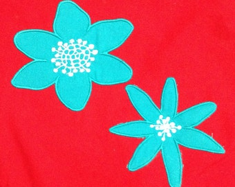 Funky, mod flower Appliqué  Designs  - 2 different styles in 3 different sizes. These groovy, 60s style flowers are bold and lovely.