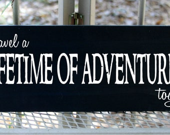 Lets travel a lifetime of adventures together wood sign