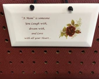 Ceramic Plaque With Beveled Edge  it is Mom saying.  3 by 6