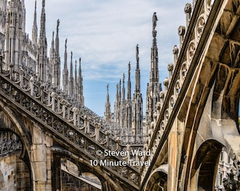 Milan Italy Duomo church roof spires, flying buttresses and marble sculptures
