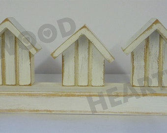 Shabby chic beach huts on stand