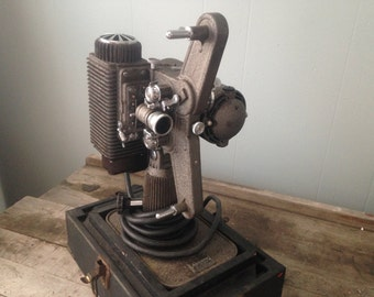 Vintage film projector, 1948 Revere Eight Projector in case with manual