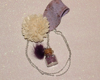 Purple magical bottle pendant