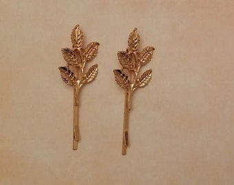 Forks with branches of golden leaves