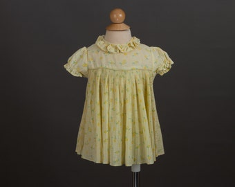 vintage 1970s baby girl's dress | yellow floral print