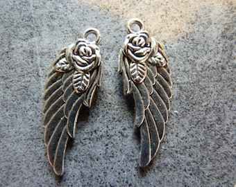 Large wing charm and silver roses