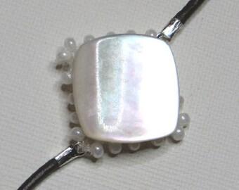 Pearl White seed - #228 on bracelet