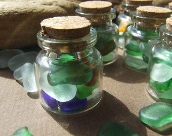 Sea glass mini bottle. Small fragments of the Mediterranean.