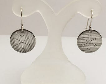 Sterling Silver snowflake cut-out earrings