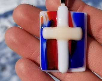 White & Cream Cross Glass Pendant. Red, White, and Blue background. Sterling Silver Bail.