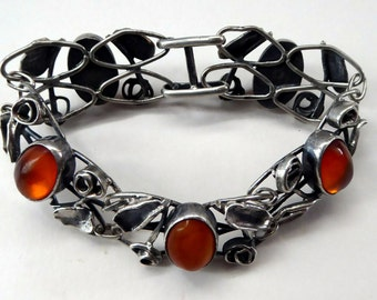 Beautifully Made Continental Silver Foliate Bracelet. Set with Five Oval Amber Stones, 1960s