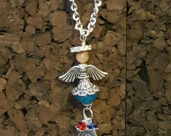 Christmas Guardian Angel pendant charm necklace handcrafted by TR Jackson. Christian mala protection necklace blue agate Jade and St Michael