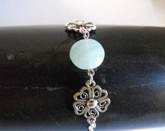 Green glass pearl bracelet fine and elegant pale silver flowers