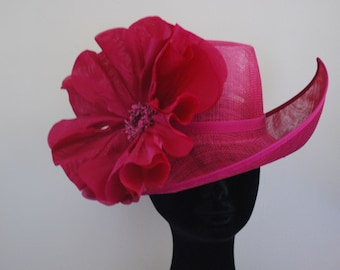 Magenta irregular shaped feature hat with silk poppy-- Style name Poppy Made to Order