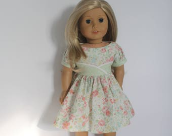 English tea rose print dress with puffed sleeves and front waist detail for 18 inch dolls such as American Girl and Our Generation