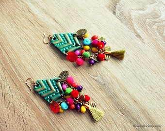 Long colorful earrings.