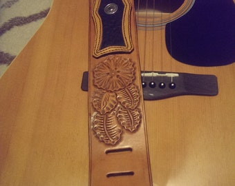 Custom made carved leather guitar strap.
