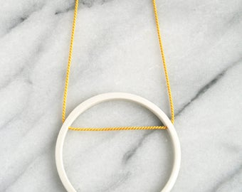 Porcelain circle pendant on yellow cord // minimalist jewellery // geometric jewellery // hoop // ceramic jewelry // scandi design // modern
