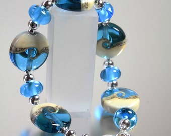 Silver and lampwork bead turquoise blue bracelet from the Coast to coast range by Helen Gorick