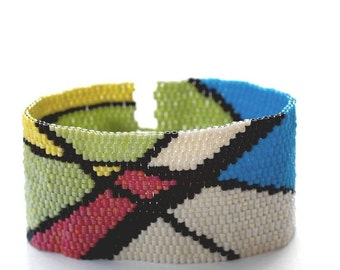 Evolutionary ... Peyote Bracelet . Beadwoven Cuff . Artistic . Bold . Abstract Design . Primary Colors . Lime Green . Black . Cream