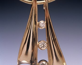 Diamond necklace in 14K Solid Gold with 3 diamonds. Diamond total weight is .18ctw.