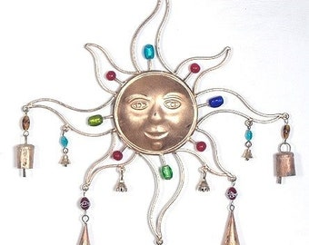 beautiful sun with bells and beads wind chimes