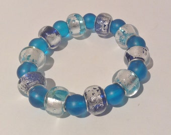 Bracelet.18cm Features blue and silver and purple and silver Foil Glass Rondel Charm beads. Blue Glass spacers