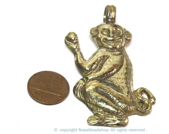 1 Pendant - Tibetan brass monkey pendant with floral carving on other side  from Nepal - PM598