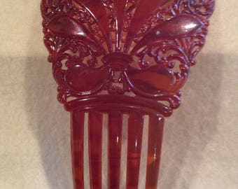 Beautiful vintage red/brown carved celluloid Victorian hair comb