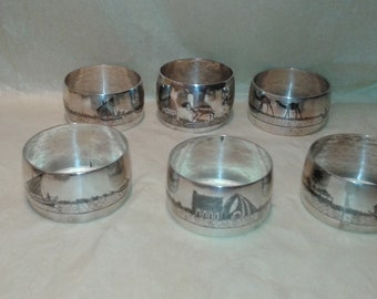 Six solid silver Iraqi niello napkin rings , marsh boat river mosque imagery , fine handmade silverware