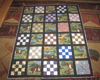 Machine Quilted hand bound horse themed lap/baby quilt