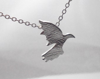 Sterling silver flying bird pendant necklace