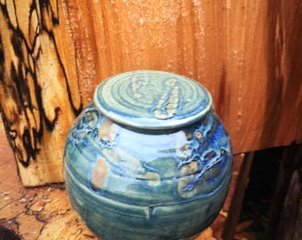 Lidded stoneware ceramic pottery pot in green