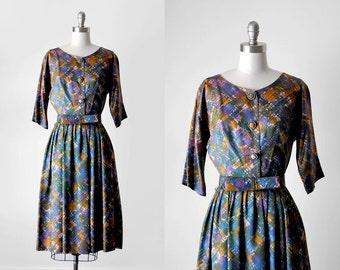 50's multicolored dress. 1950 purple full dress. print. bow belt. pleated. m. 1950's watercolor dress.