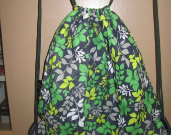 "shoulder bag backpack, backpack, bag has cotton shoes lined in pul plain green 16 ""hautx14"" wide"