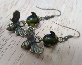 Moss green glass and honey bee earrings
