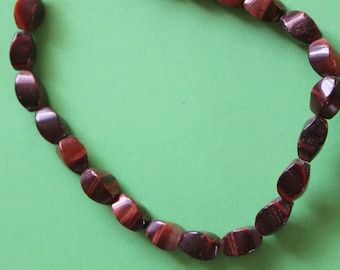 Red Tiger's Eye 10x6mm Twisted Oval Beads - Full Strand (Free UK Postage)