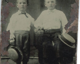 Tintype of two little boys holding hats