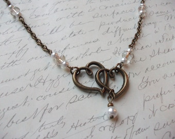 Double hearts with pearls and crystal antique brass necklace
