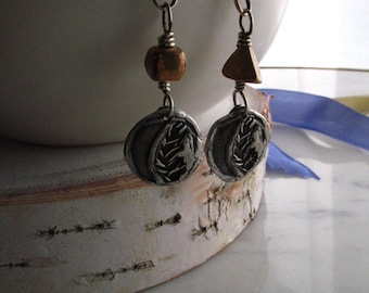 silver crescent moon and leaf earrings : mismatch beaded earrings . bronze . sterling silver .