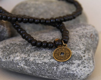man bracelet bead or mala necklace Buddhist wood