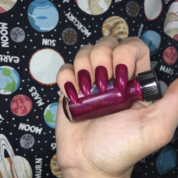 Cat Eye Nebula Catventures in Space cranberry holographic vegan nail polish
