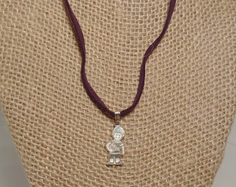 Child charm with leather necklace