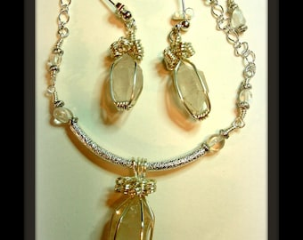 Caged double ended terminated quartz crystal necklace and earring set