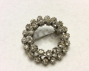 Vintage 1940's double row clear colorless rhinestones circle brooch pin.