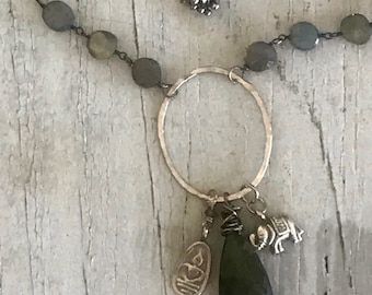 Loyal. Small labradorite coin chain suspend a hand-forged oval with a labradorite briolette, fine silver elephant and sitting Buddha charm.