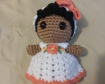 Small WeeBee doll in white/orange dress