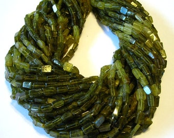 "Grossular green garnet shaded rectangular beads full 14"" stand."