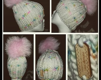 Handmade knitted hat with arctic fox pompom