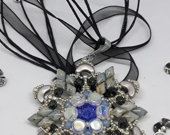 Picasso Green Medallion, eight-pointed star pendant, Swarovski crystals, precision beading creation, fashion triangle pendant.